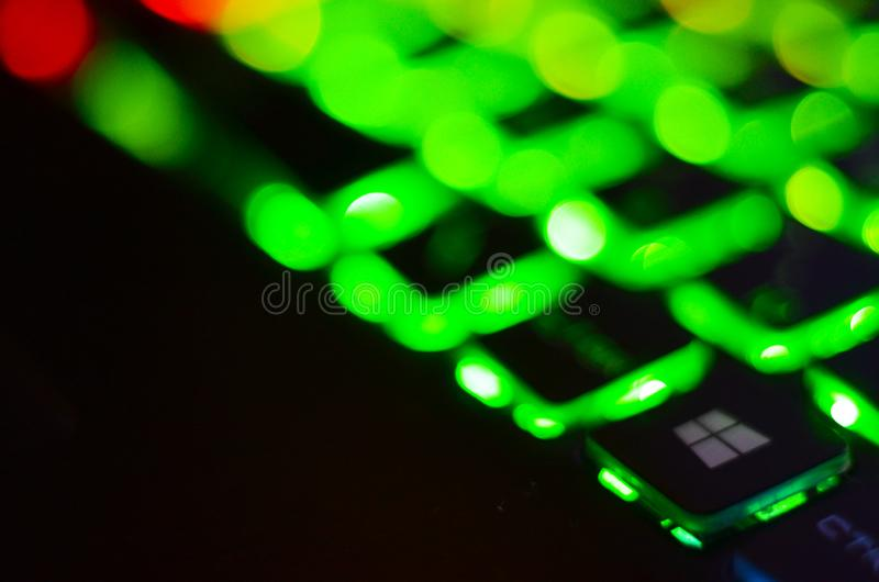 Laptop keyboard with blue backlight. Buttons closeup.  royalty free stock images