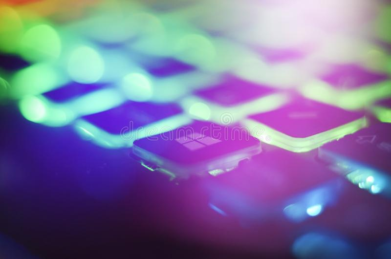 Laptop keyboard with blue backlight. Buttons closeup.  stock photo