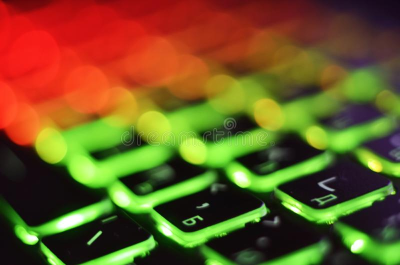 Laptop keyboard with blue backlight. Buttons closeup.  royalty free stock photo