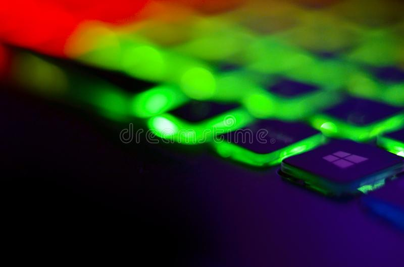 Laptop keyboard with blue backlight. Buttons closeup.  royalty free stock photography