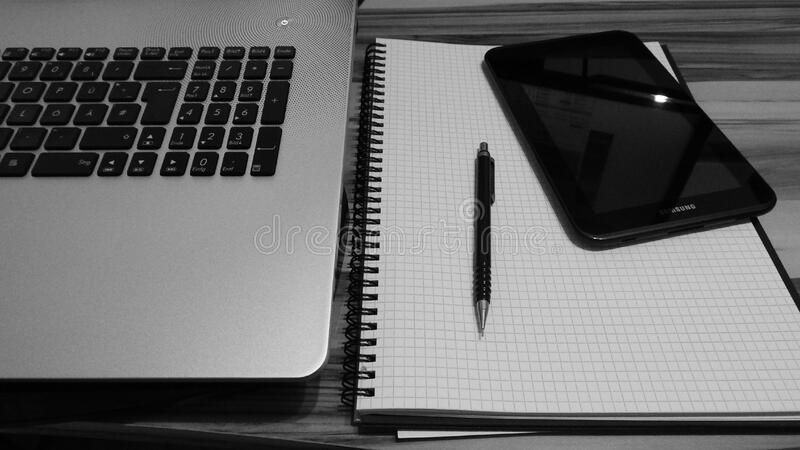 Laptop keyboard and note pad royalty free stock photos