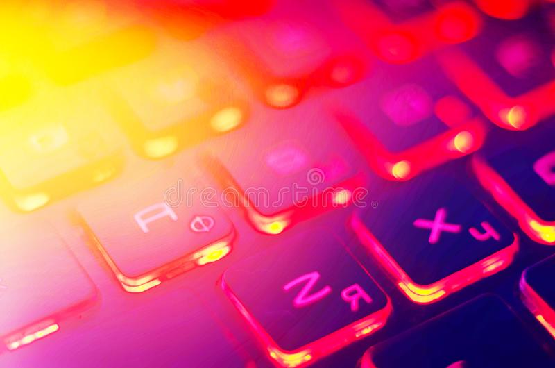 Laptop keyboard with red backlight. Buttons closeup.  stock images