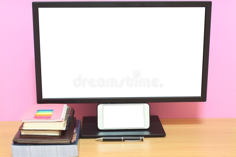 Laptop książki i umieszczamy na biurku i co fotografia stock