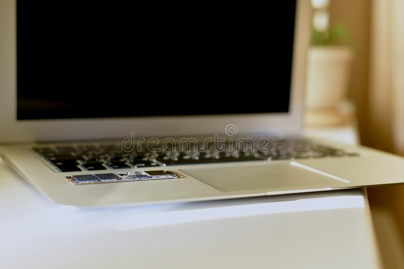 Laptop open on the work surface at an angle. royalty free stock photo