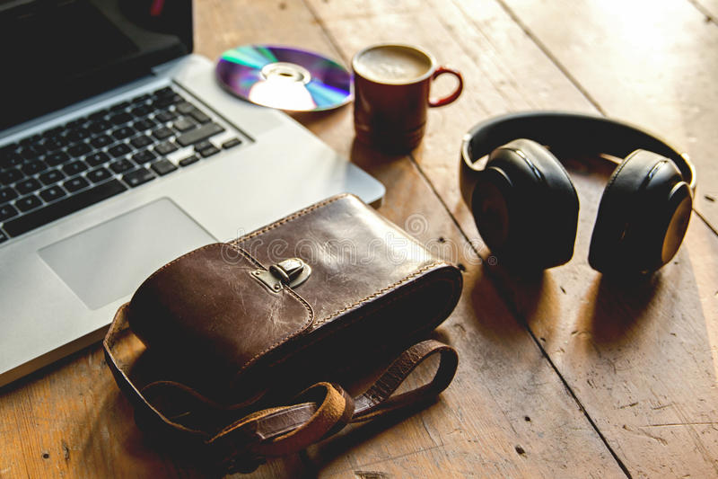 Laptop, listening to music, on headphone chilling with an espresso, coffee royalty free stock photo