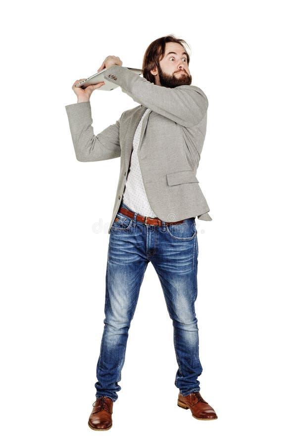 Laptop lucht houden en zakenman die gillen stock foto