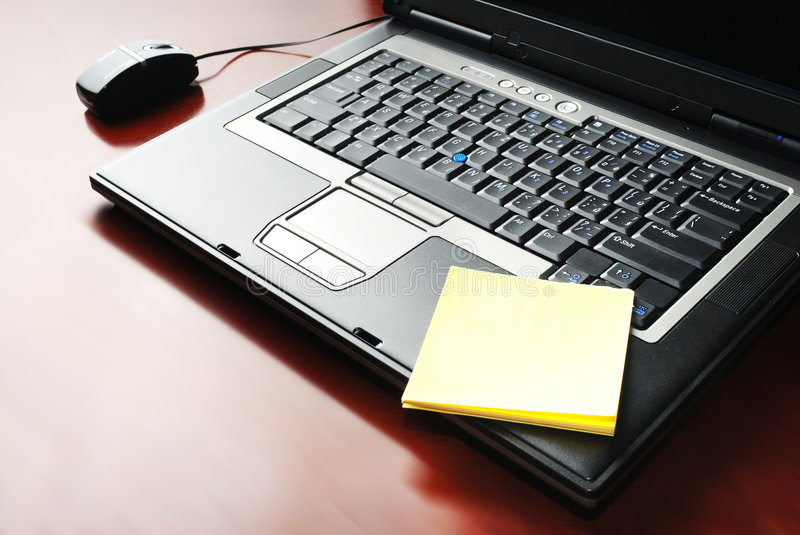 Laptop and Message Slip. Organizer in design light stock images