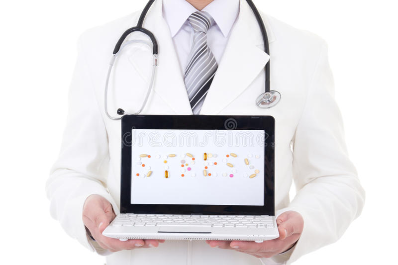 Laptop met woordspanning in de handen van de arts die op wit wordt geïsoleerd royalty-vrije stock foto