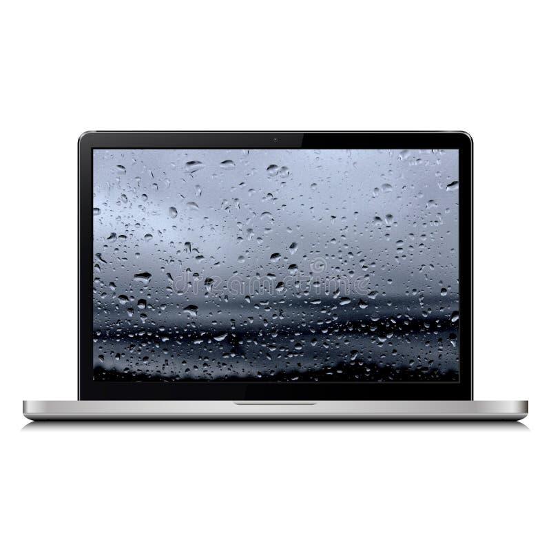 Laptop mit Regentropfen lizenzfreie stockfotos