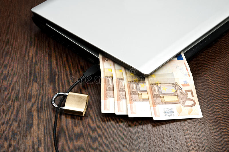 Laptop and money royalty free stock photo