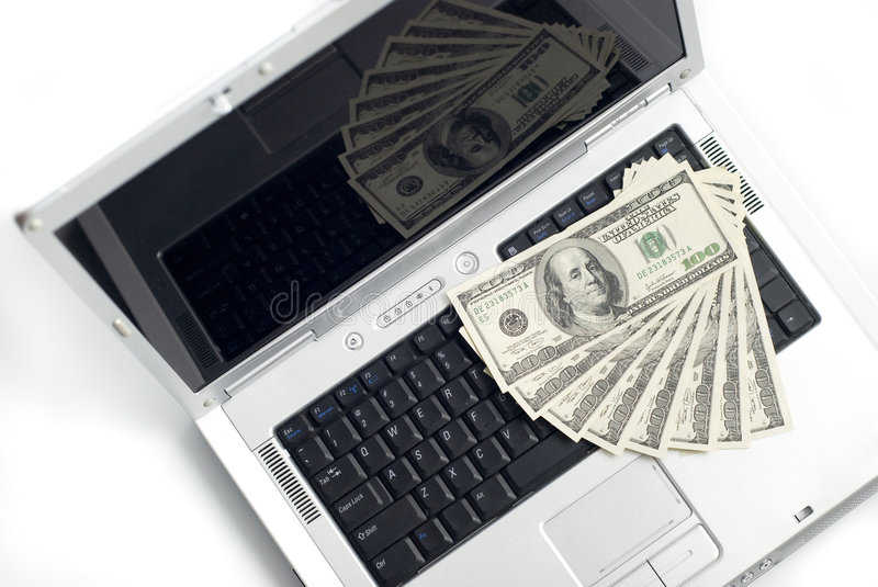 Laptop And Money Stock Photo
