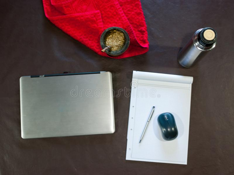 the laptop, the mouse, and the note pad stock photo