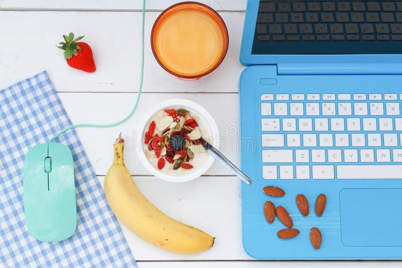 Breakfast at work stock photography