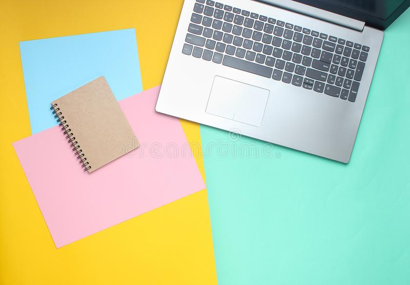 Laptop, notebook on a colored pastel background, modern workspace, minimalism, flat lay style, top view. stock image