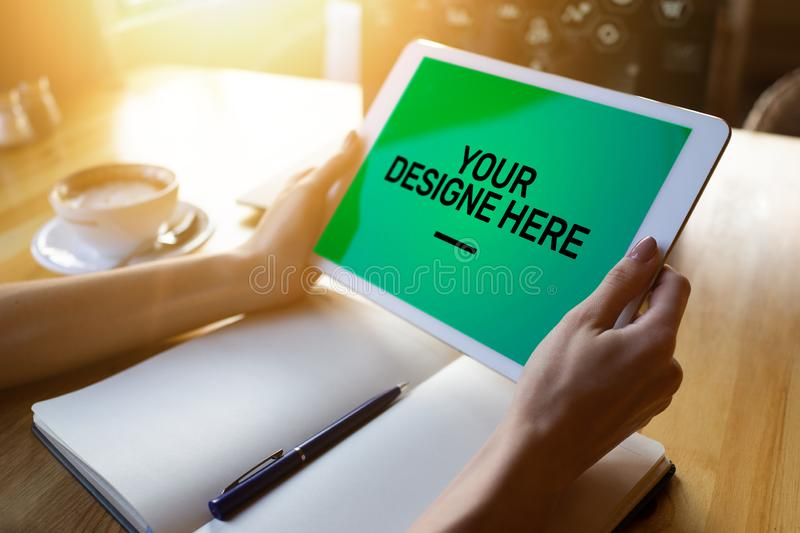 Laptop, Notebook, tablet pc Mockup screen with green chroma key background and text Your Design here Empty copy space. stock image