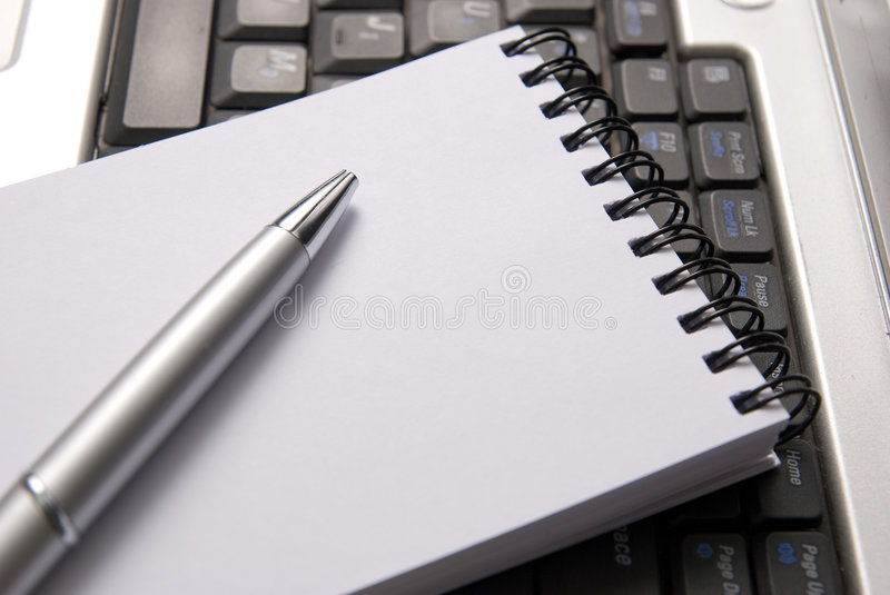 Laptop, Notebook And A Pen Royalty Free Stock Photos