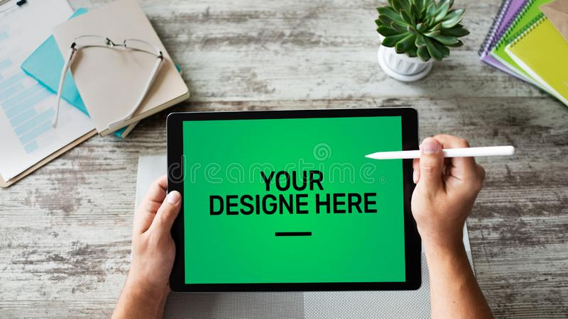 Laptop, Notebook, tablet pc Mockup screen with green chroma key background and text Your Design here Empty copy space. stock photography