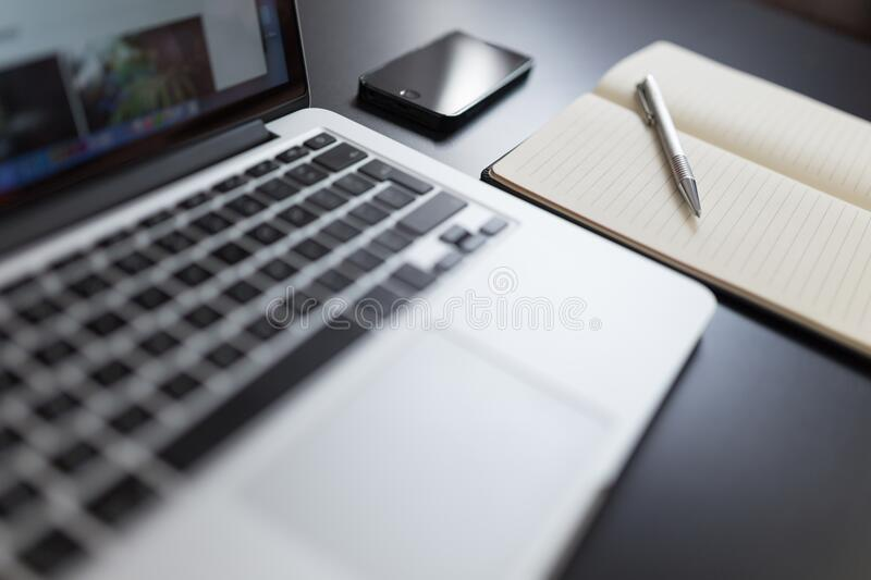 Laptop and notepad stock photos