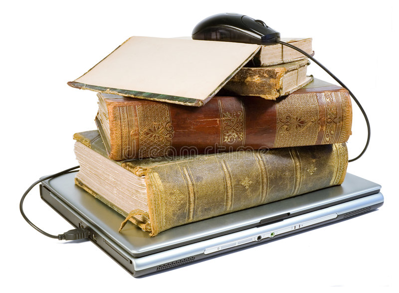 Laptop and old books with path stock photo
