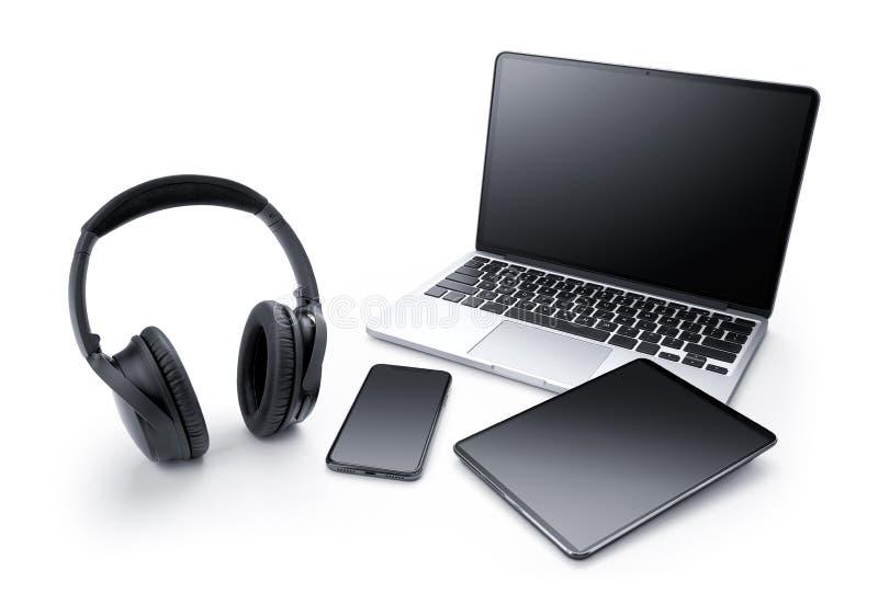 Laptop, pastylka, smartphone i hełmofon, zdjęcia stock