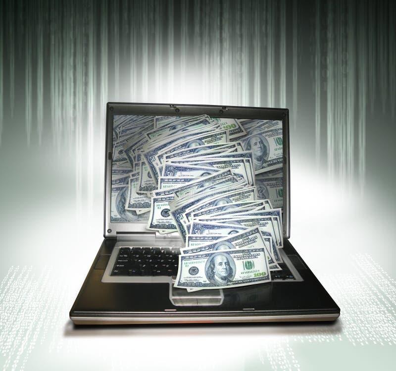 Laptop PC mit Geld stockfoto