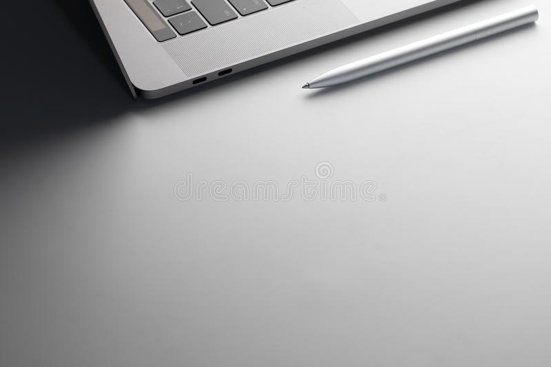 Laptop and pen on Business Desk. Working environment stock photo