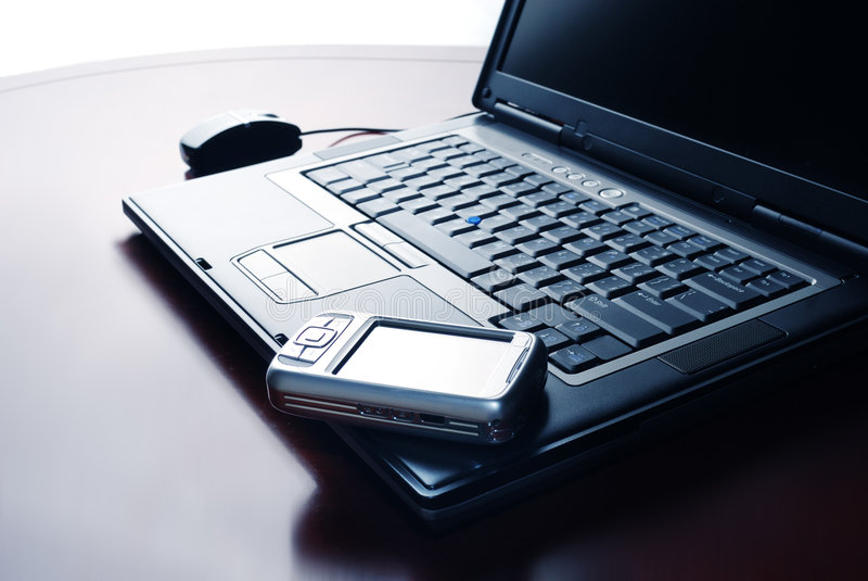 Laptop and Pocket PC. Organizer in design light royalty free stock photo