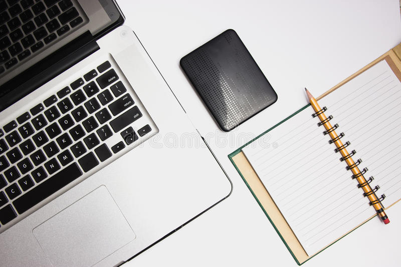 Laptop with portable hard drive and pad stock photos