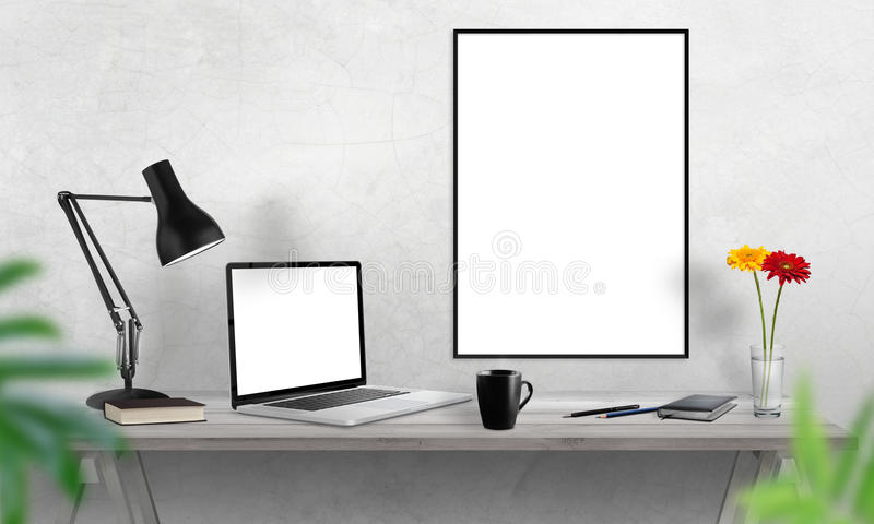 Laptop and poster frame on office desk. Coffee, cactus, notebook, lamp on table stock image