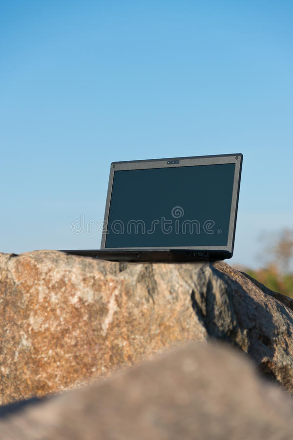 Download Laptop on rocks stock image. Image of blue, photography - 28171141