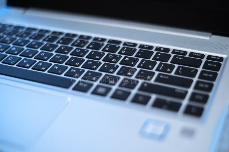 Laptop russian keyboard. Blue silver stock photography