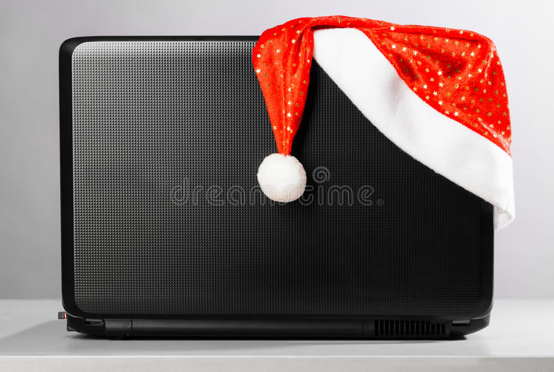 Download Laptop with santa hat stock photo. Image of mobile, internet - 28118552