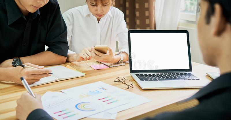 Laptop screen is blank. Team that helps brainstorm work. To achieve the goal, Concept teamwork that has the technology stock photography