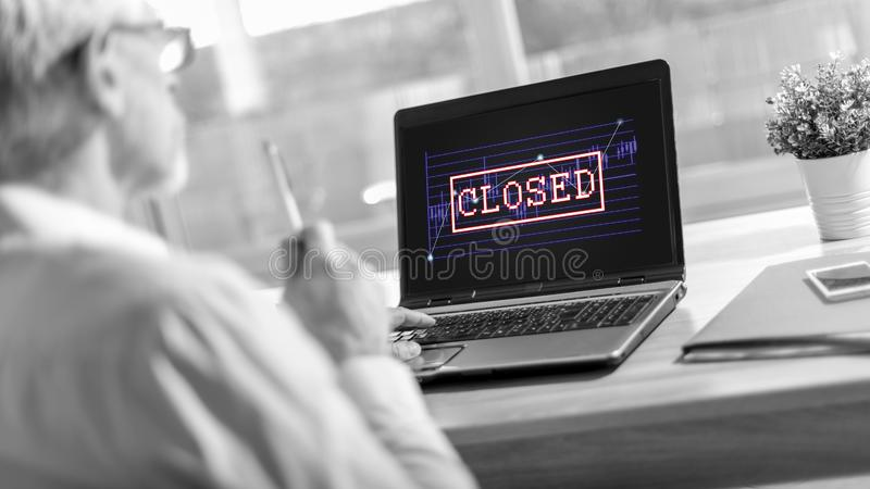 Closed stock market concept on a laptop screen royalty free stock image