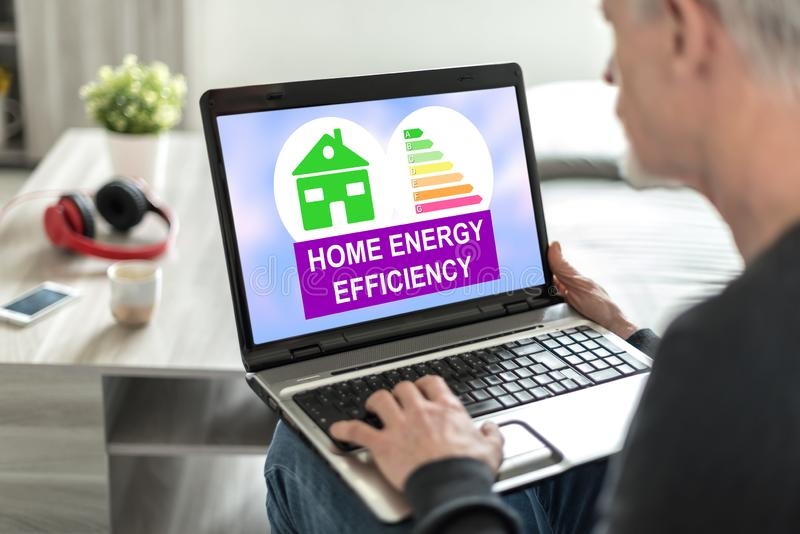 Home energy efficiency concept on a laptop screen. Laptop screen displaying a home energy efficiency concept royalty free stock photos