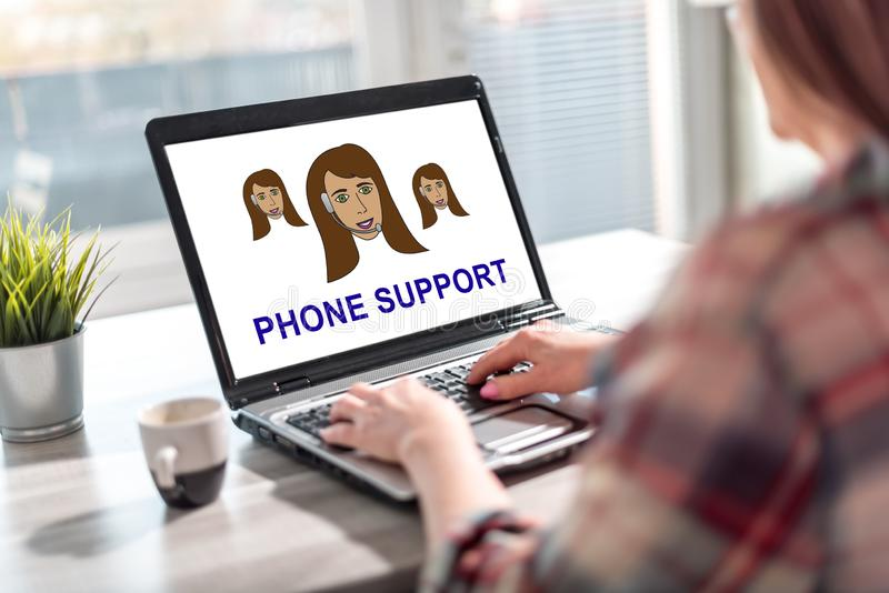 Phone support concept on a laptop screen royalty free stock photo