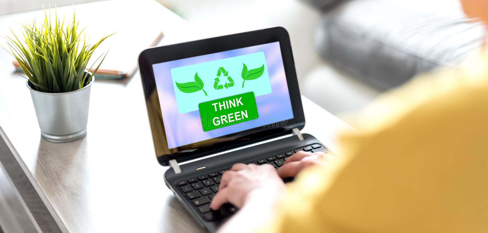 Think green concept on a laptop screen stock image