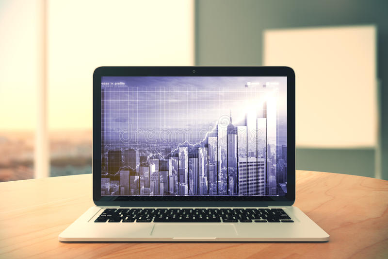 Laptop screen with double explosure city and business graph on w stock images
