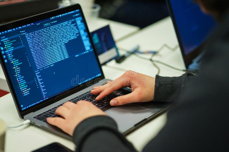 Laptop screen with lines of code. Programmer writes an application in the programming language. stock photo