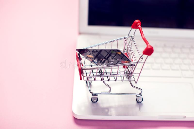 Laptop with shopping trolley. Online shopping concept royalty free stock photography