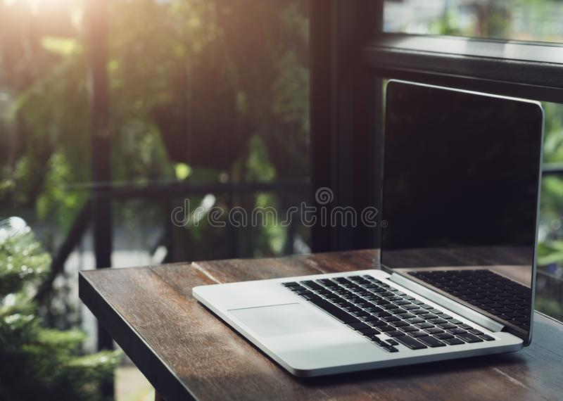Laptop showing blank screen in coffee shop restaurant, Comfortable working place, Close-up of comfortable working place in office stock photography
