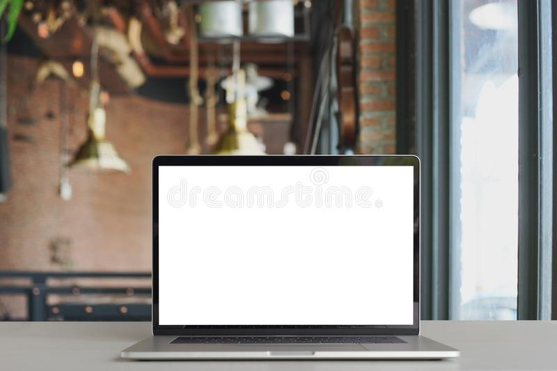 Laptop showing white screen in coffee shop royalty free stock photo