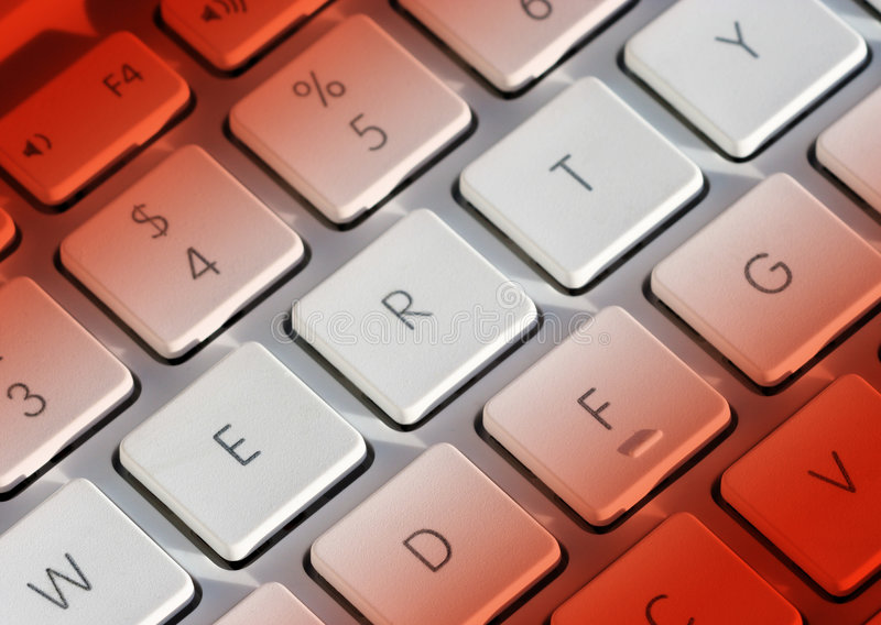 Laptop sleutels in rood royalty-vrije stock afbeelding
