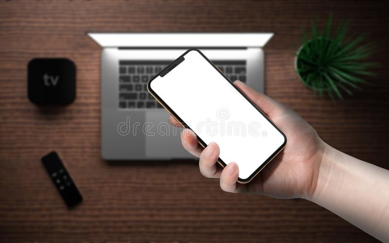 Laptop smartphone digital media player device remote touch controller. Laptop and smartphone with blank screen, digital media player device with remote touch royalty free stock photos