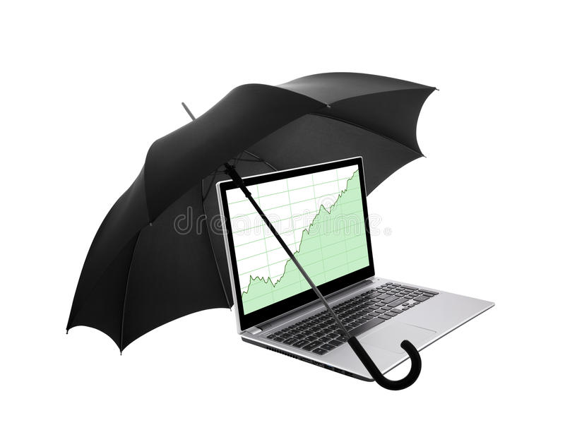 Laptop with stock charts protected by an umbrella stock photography