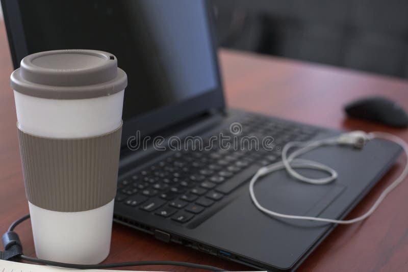 Laptop on a table stock photos