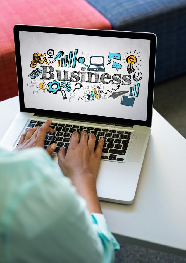 Laptop on table showing blue and yellow business doodles against white wall. Digital composite of Laptop on table showing blue and yellow business doodles stock image