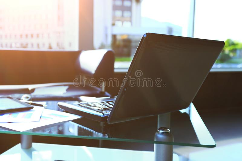 Laptop with tablet and smartphone in the workplace stock photos