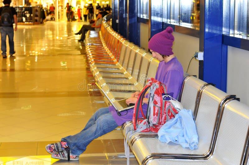 Laptop teen and Cap stock photo