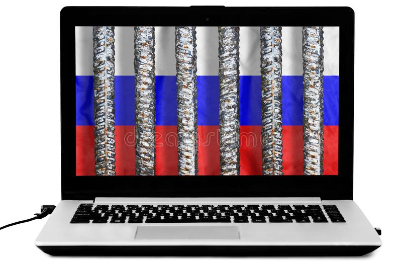 Laptop with thick metal prison grate and a russian flag on the screen isolated on white background royalty free stock photo